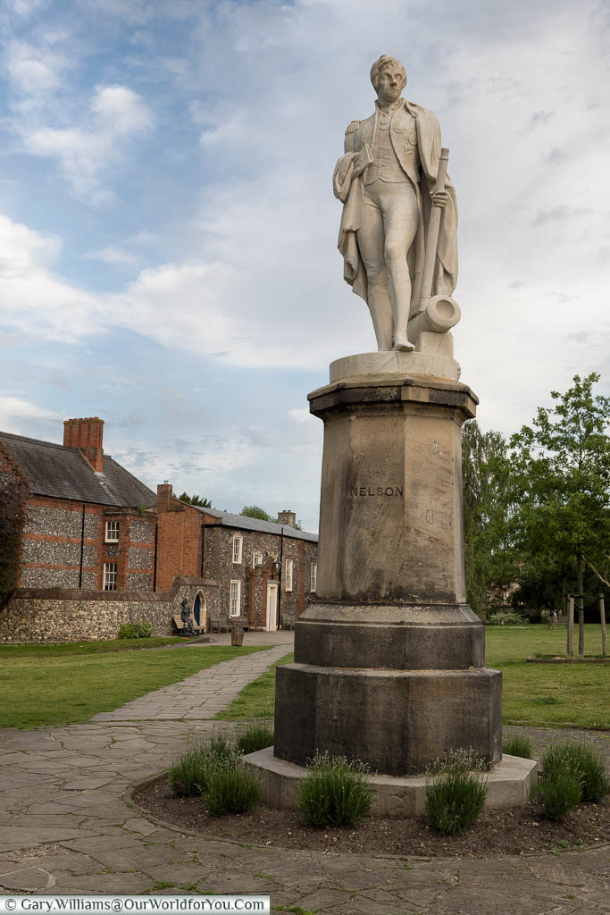 A stone statue of Lord Horatio Nelson in the grounds of Norwich Cathedral
