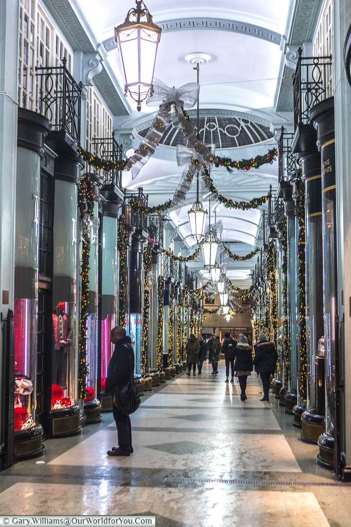 Picadilly Arcade, a row of bespoke shops, in an ornate pedestrian thoroughfare in the west end of London, selling the finer things in life