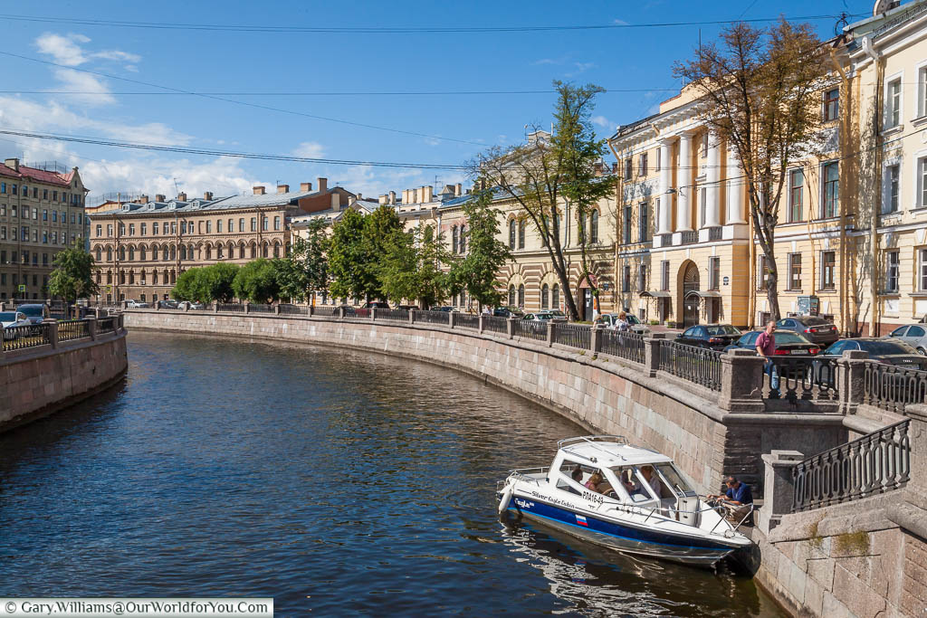 A small private boat moored up on the Griboedov Canal in Saint Petersburg, Russia