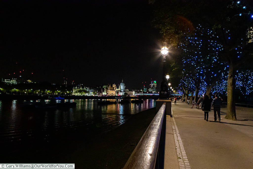 Strolling along the Southbank of the River Thames in London at night