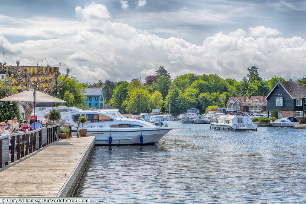 Pleasure boats navigating the Norfolk Broads at Wroxham, Norfolk