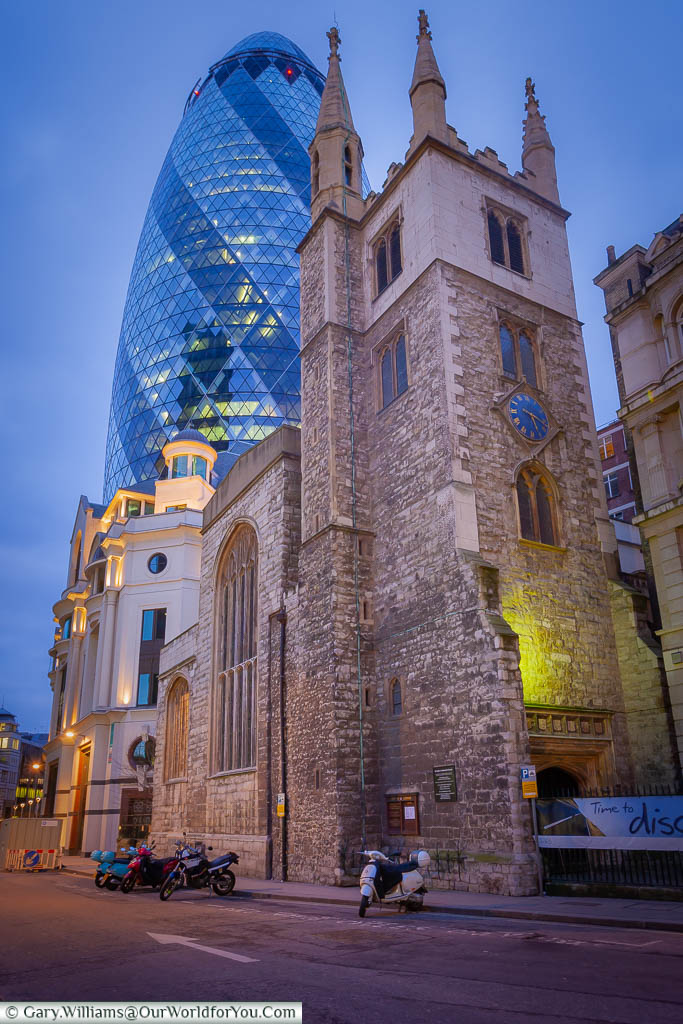 A view of 30 St Mary Axe behind St Andrew Undershaft Church after the sun has done down.