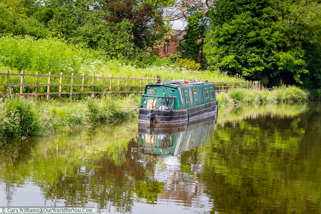 A personal narrowboat moored up in an idyllic spot on the Kennet and Avon canal.