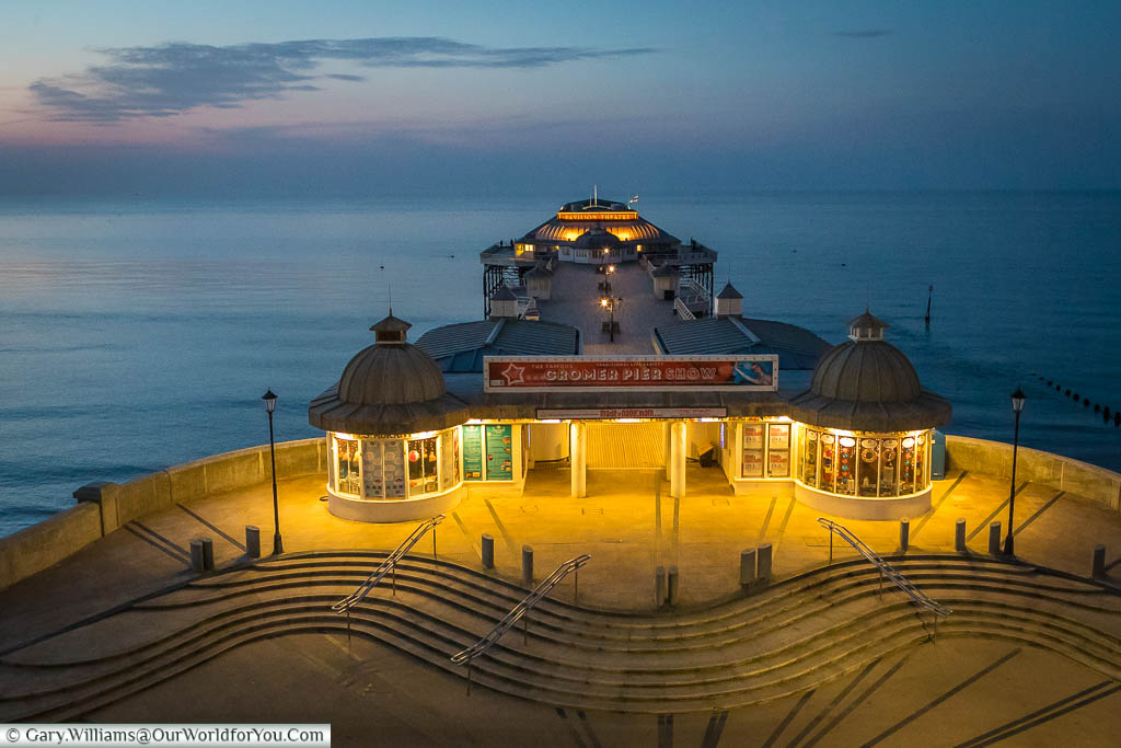 Looking down on the entrance to the illuminated Cromer Pier.