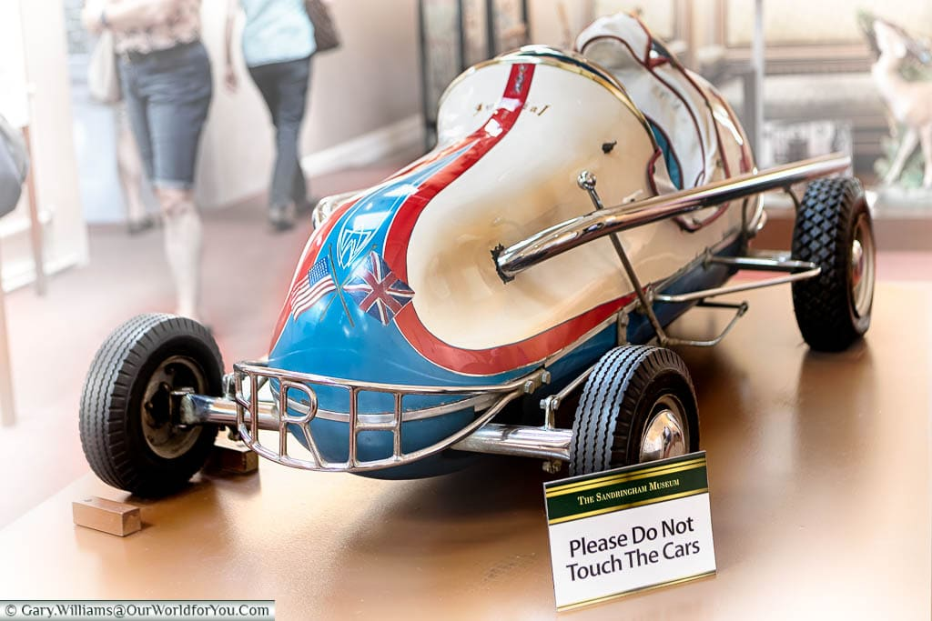 A vintage toy race car for the Princes' to sit in, in the Sandringham Museum
