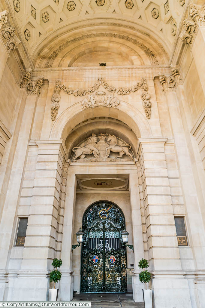 The decorative stone arch conceals iron gates at one of the entrances to the Royal Exchange