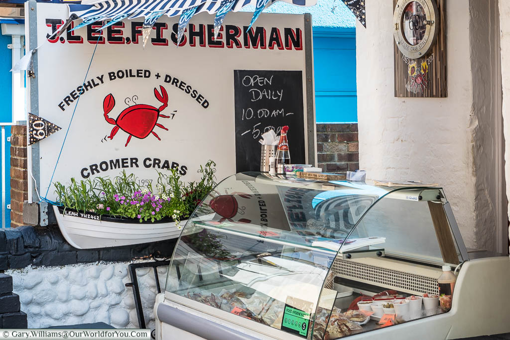A refrigerated stall selling freshly boiled and dressed Cromer crabs outside a shop in Cromer.