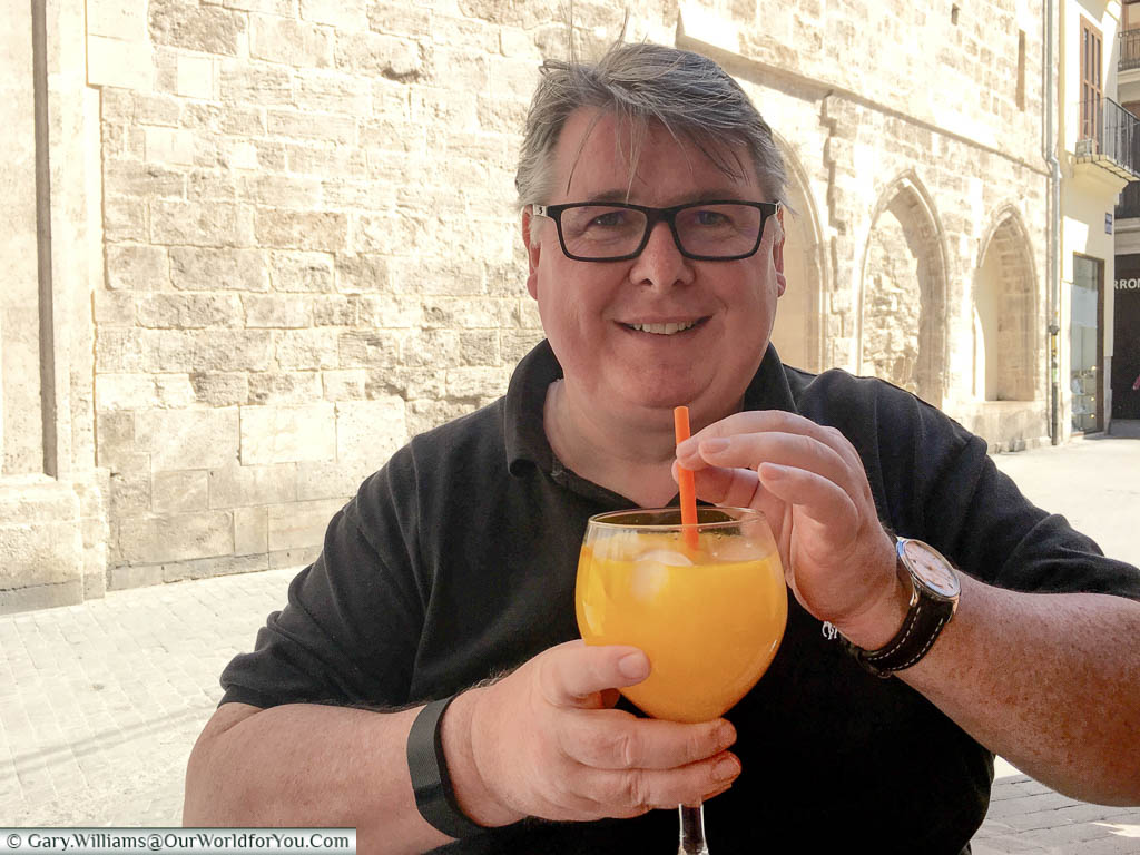 Gary with a large glass of Agua de Valencia in central Valencia, Spain