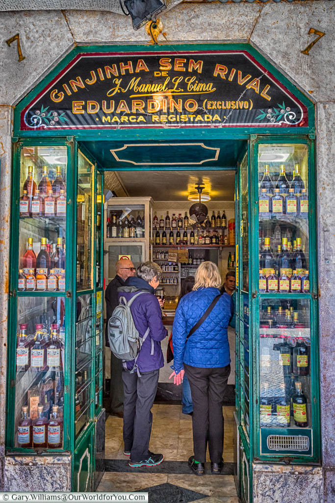 Queuing for a shot of Ginjinha Sem Rival at a tiny little shop in the centre of Lisbon, Portugal