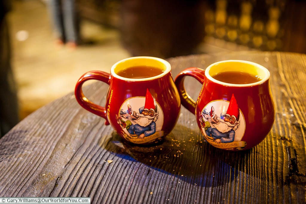 Two glasses of steaming Gluhwein in the souvenir mugs at the Christmas Markets in Cologne, Germany