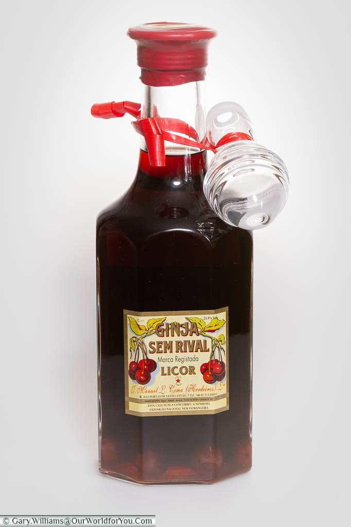 A single bottle of Ginjinha, in which you can clearly see the cherries in the bottom of the bottle, brought back from Lisbon, Portugal