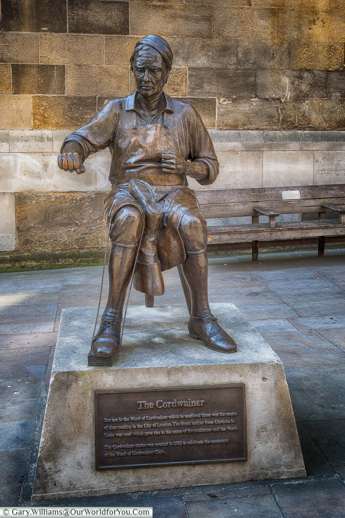 A brass statue to a cordwainer, or shoemaker, to designate the area known as the Ward of Cordwainer