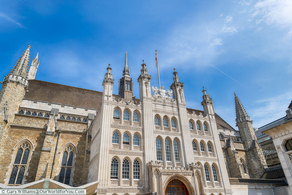 The exterior of the Guildhall in the City of London under a deep blue sky