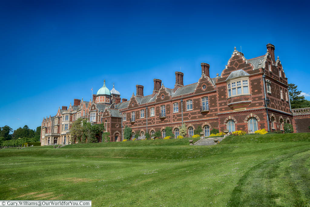 The rear of Sandringham House, as seen from the neatly manicured lawns of the Royal Residence.