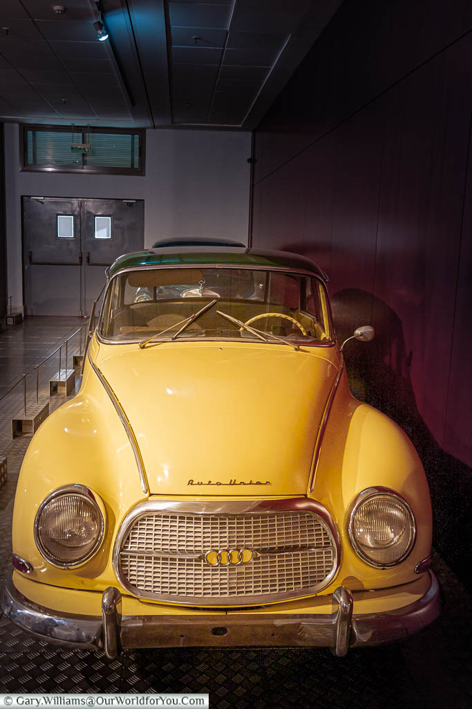 A bright yellow post-war Auto Union saloon car on display in the Museum of Automotive History in Salamanca Spain