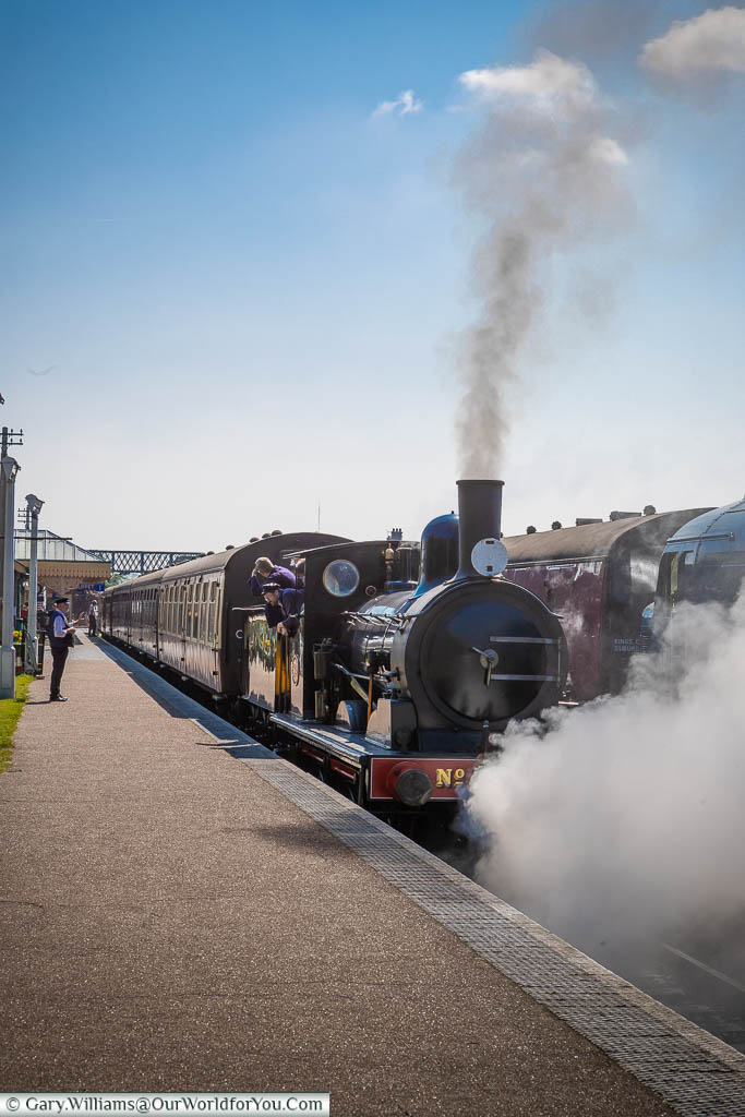 A steam train preparing to depart the Sheringham station at the North Norfolk Railway.