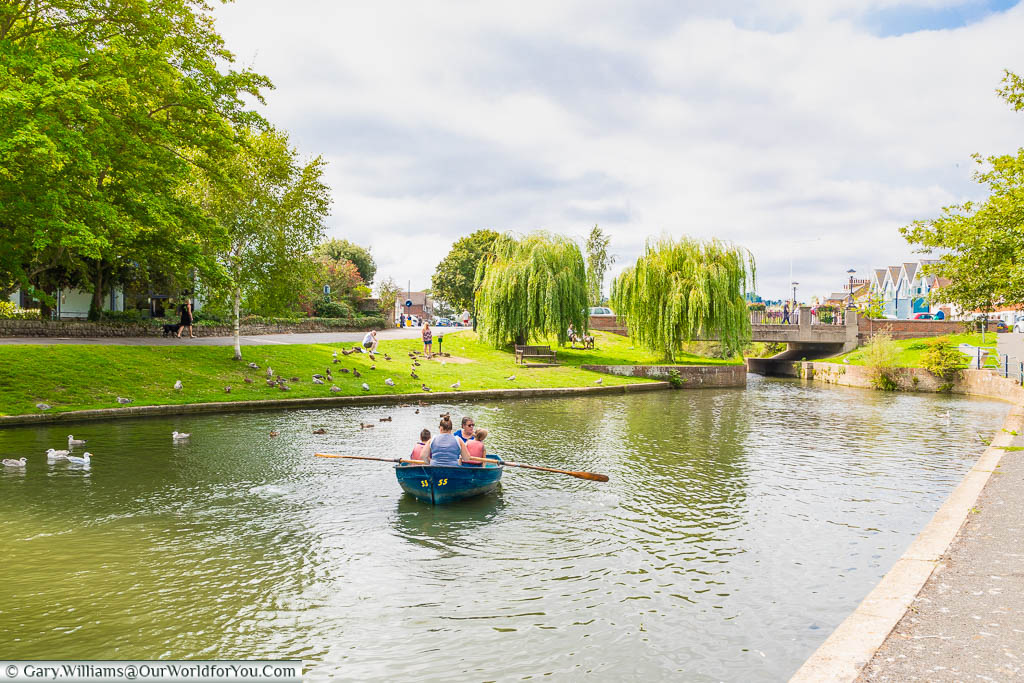 A family boating on the Royal Military Canal in Hythe, Kent