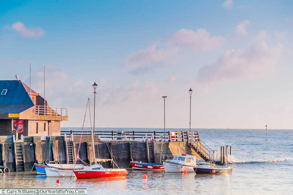 Litlle sailing boats at anchor in Broadstairs harbour on a bright sunny day