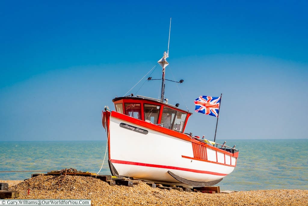 The Morning Haze small wooden fishing boat, flying the Union Jack, in the single beach of Deal