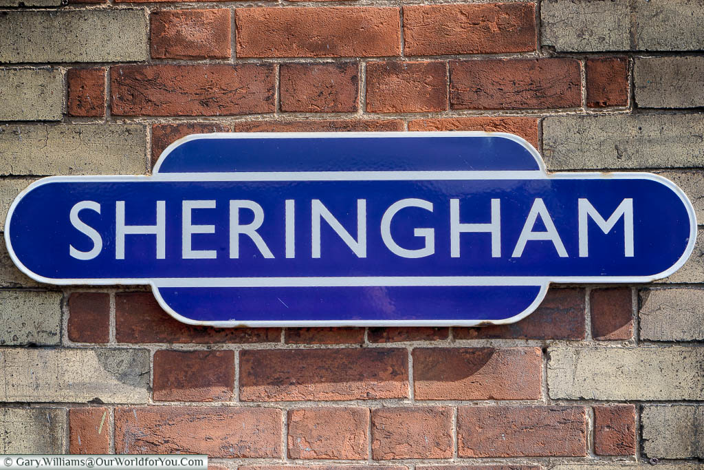 The platform sign for Sheringham Station on the North Norfolk Railway in the iconic white lettering on a mid-blue background.