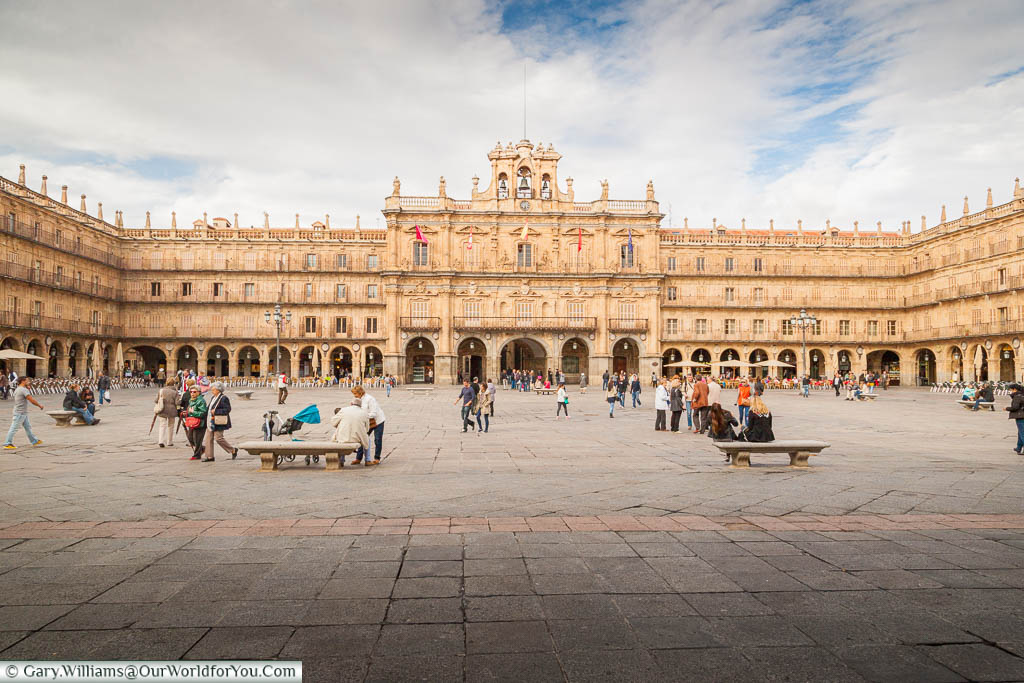The impressive, bustling, Plaza Mayor of Salamanca, surrounded on all side by the traditional Spanish baroque style architecture.