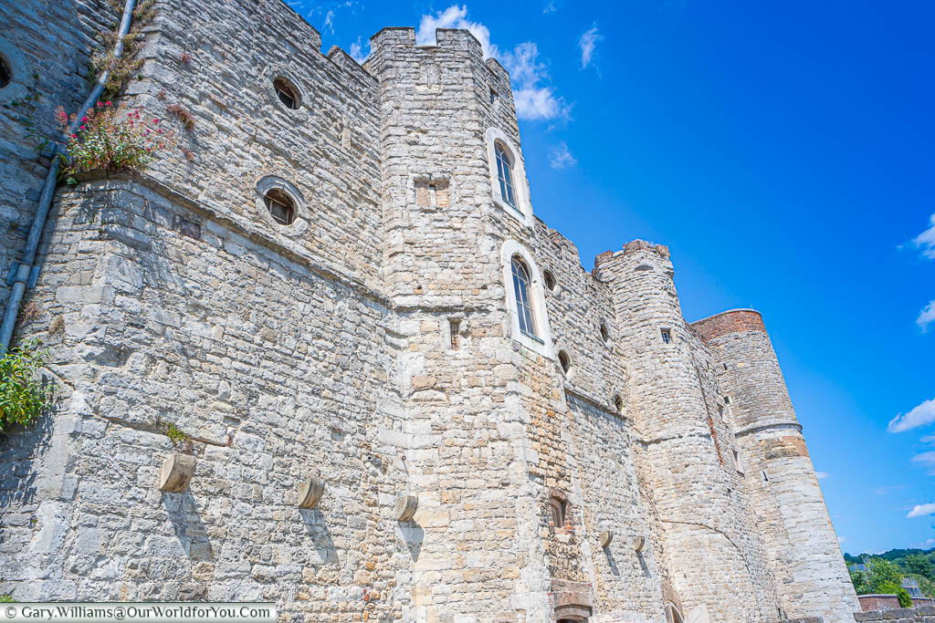 Looking up at the stone river-facing facade of Upnor Castle on the River Medway in Kent