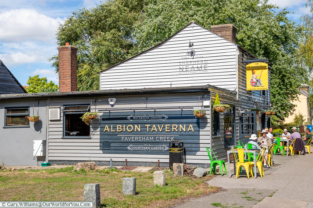 Brightly coloured tables & chairs outside the Shepherd Neame owned Albion Taverna along Faversham Creek.