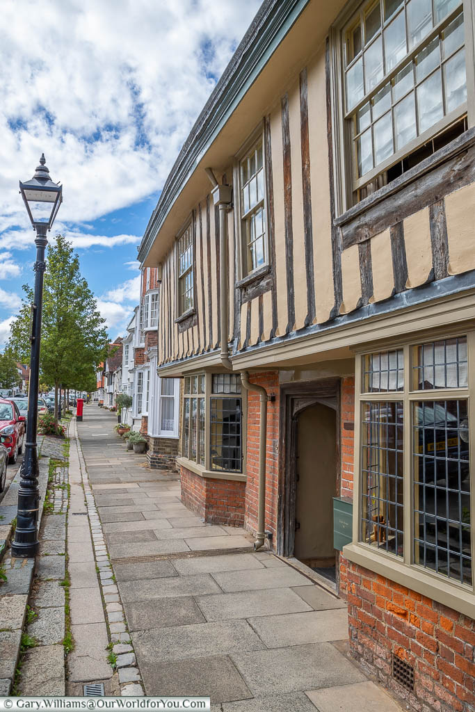 Globe House, a half-timbered building on Abbey Street with its flagstone paths and traditional street lighting.