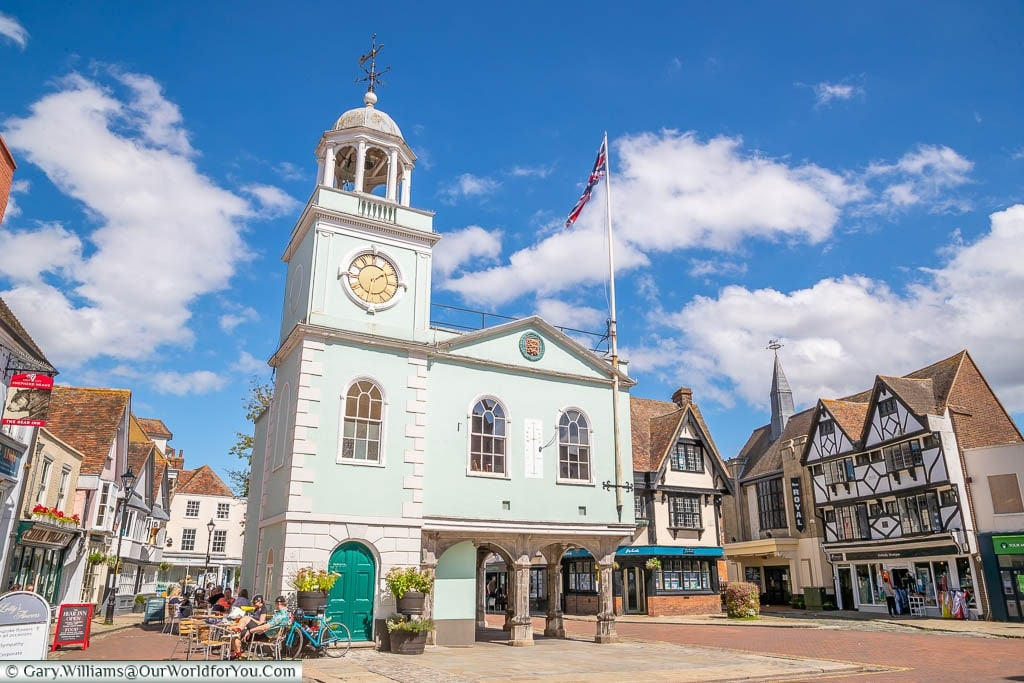 A view of Faversham Guildhall in Market Place surrounded bu cafes, restaurants and pubs