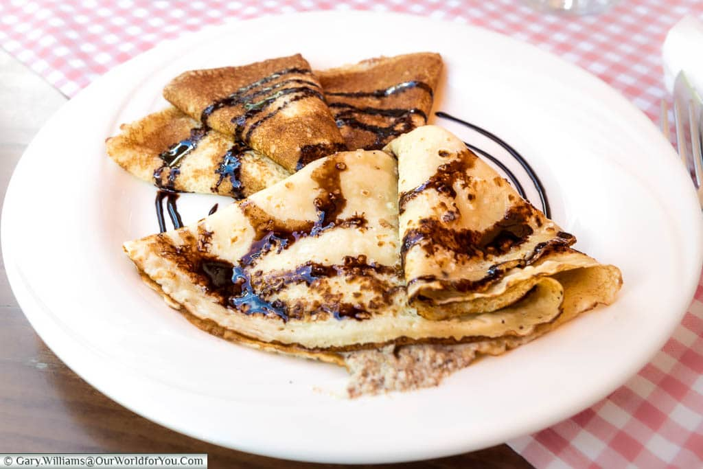 Croatian pancakes stuffed with a walnut filling and drizzled with a chocolate sauce.