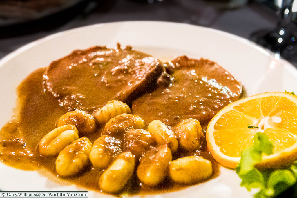 Slices of beef in a dark rich sauce served with gnocchi