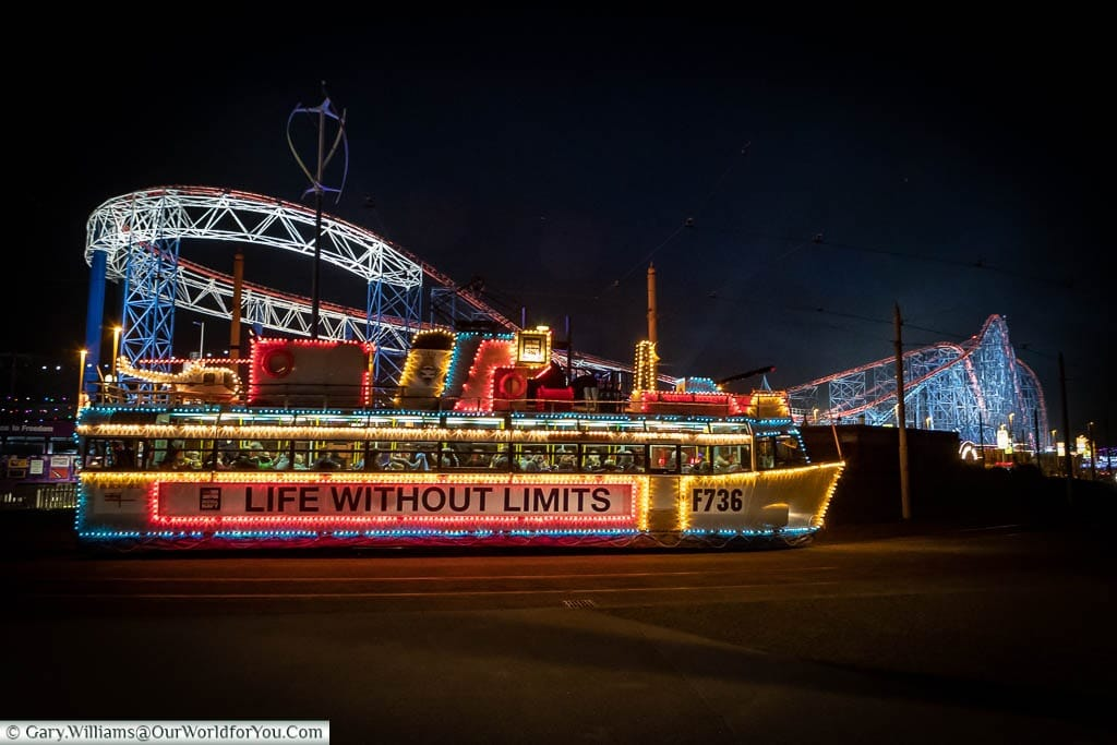 The 'Frigate Tram' waiting outside the Pleasure Beach during Blackpool's Illuminations.