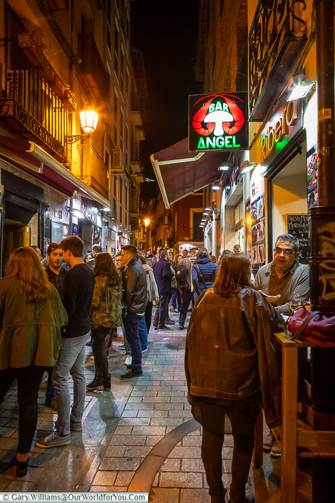 People lined up outside tapas bars on The narrow, pedestrianised, Calle del Laurel in Logroño