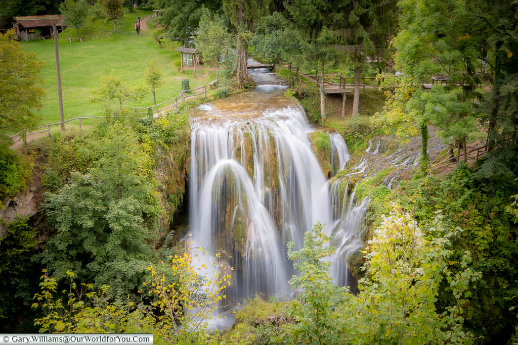 Water flowing over rocks against the lush green background of Rastoke in Croatia