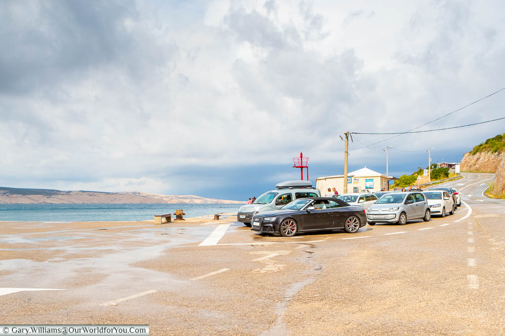 Our Audi convertible parked up at the queue for the ferry on a slipway at Čemu Priša in Croatia