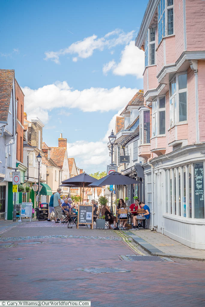 Diners sitting outside restaurants at the top of West Street in Faversham.