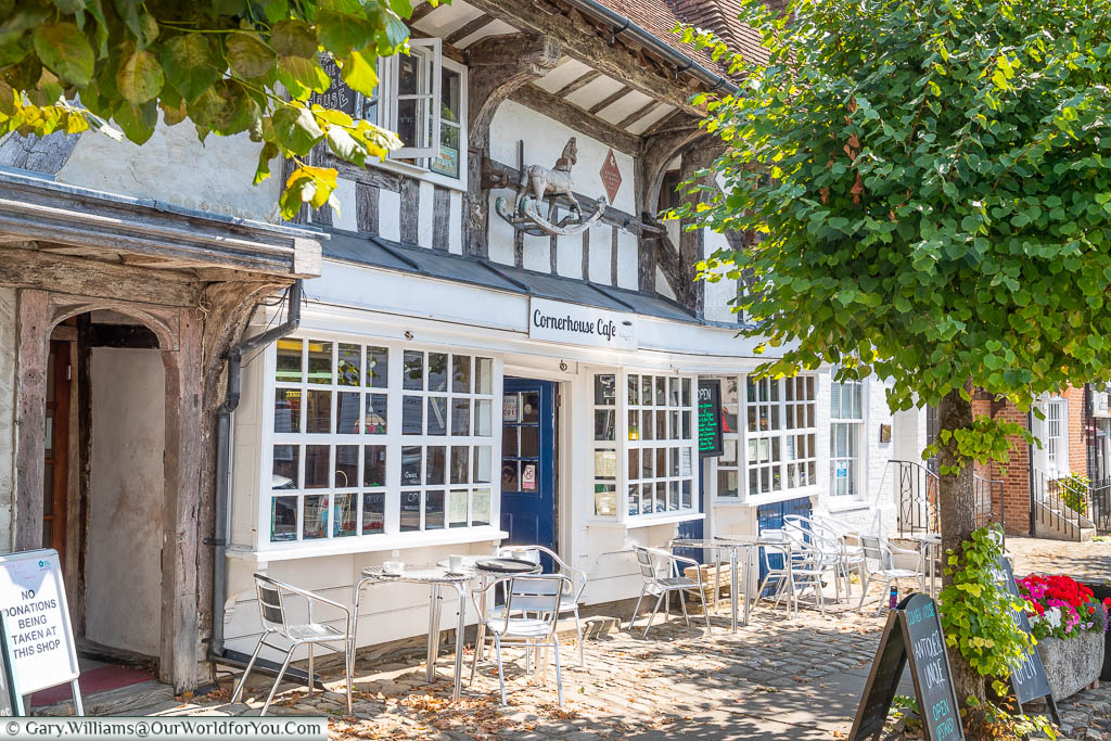 Tables and chairs outside the half-timbered Cornerhouse Café in Lenham