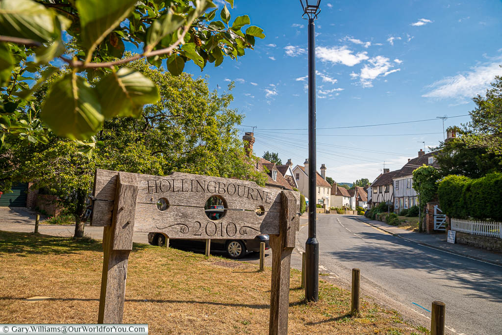 The village sign for Hollingbourne etched on a pillory, commissioned in 2010
