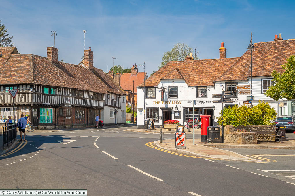 The crossroads at Lenham village square featuring historic buildings including the Red Lion pub
