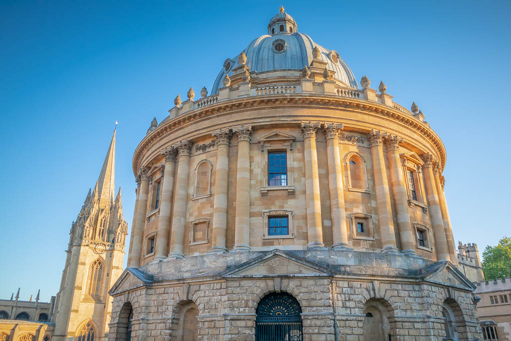 The Radcliffe Camera with the spire of the University Church of St Mary the Virgin in the background.