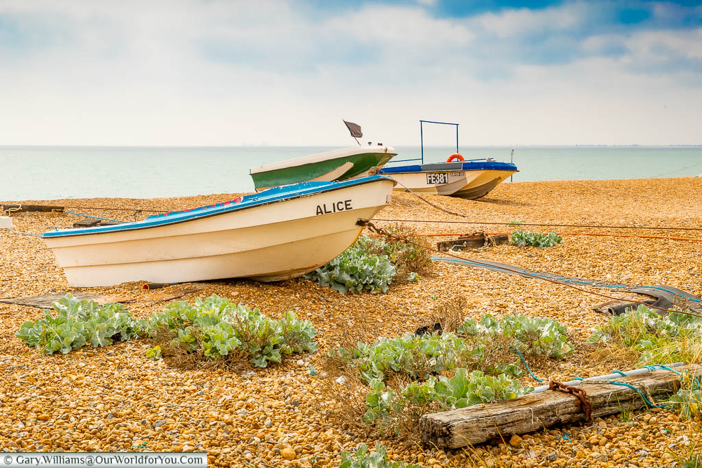 Tiny fishing boats  on the shale beach at Hythe in Kent