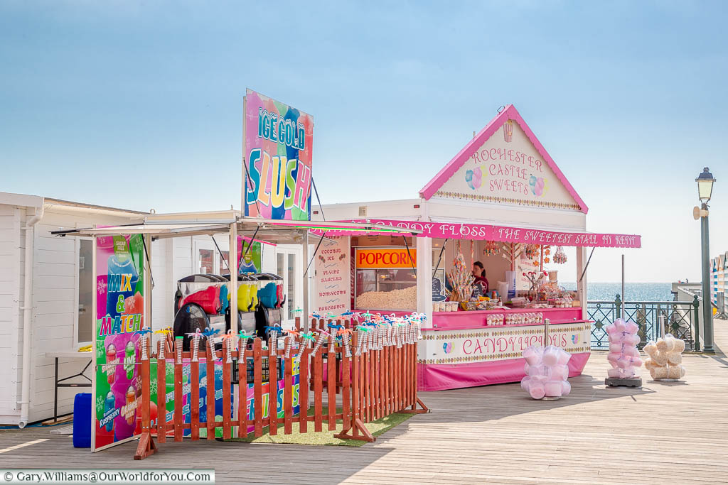 Traditional stalls on Hastings Pier selling candyfloss, slush puppies, popcorn & sticks of rock
