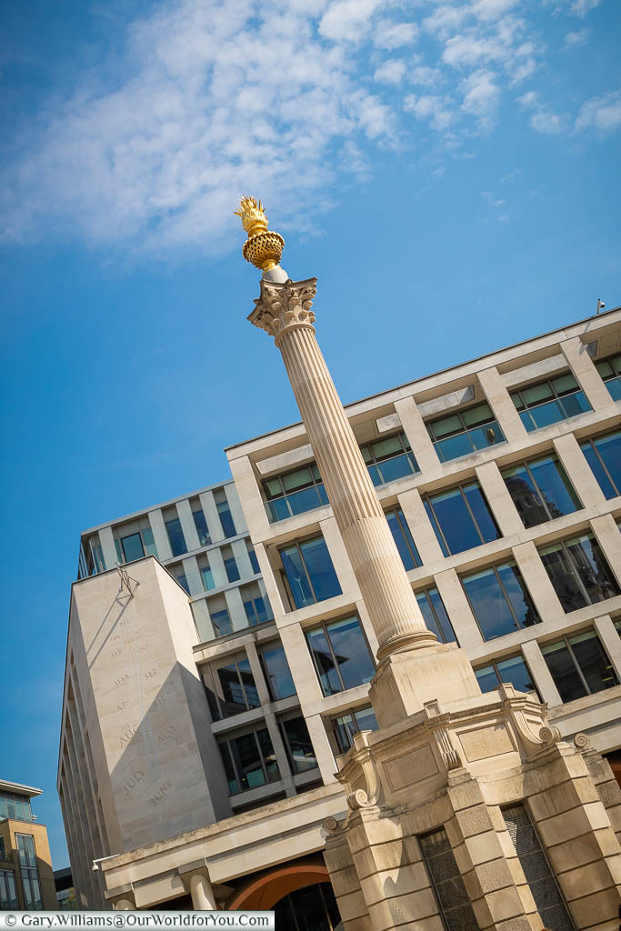 The Paternoster Square column, topped with flaming copper urn, in front of the London Stock Exchange