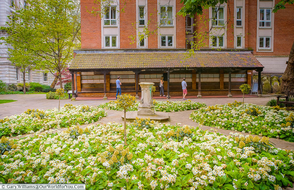 The flower beds in Postman's park in the City of London in front of the memorial for heroic sacrifice.