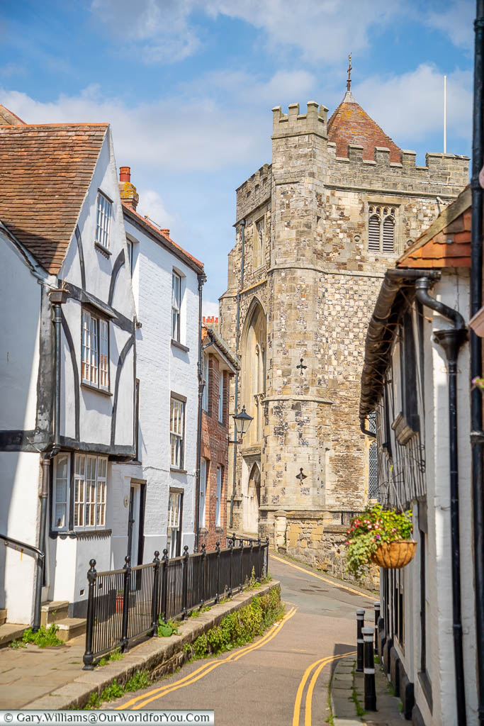 A view of the tower of St Clements Church from Hill Street, lined on either side by half-timbered houses
