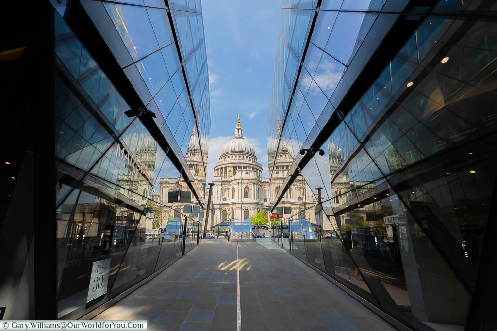 The view of St Paul's cathedral reflected in the shops of One New Change