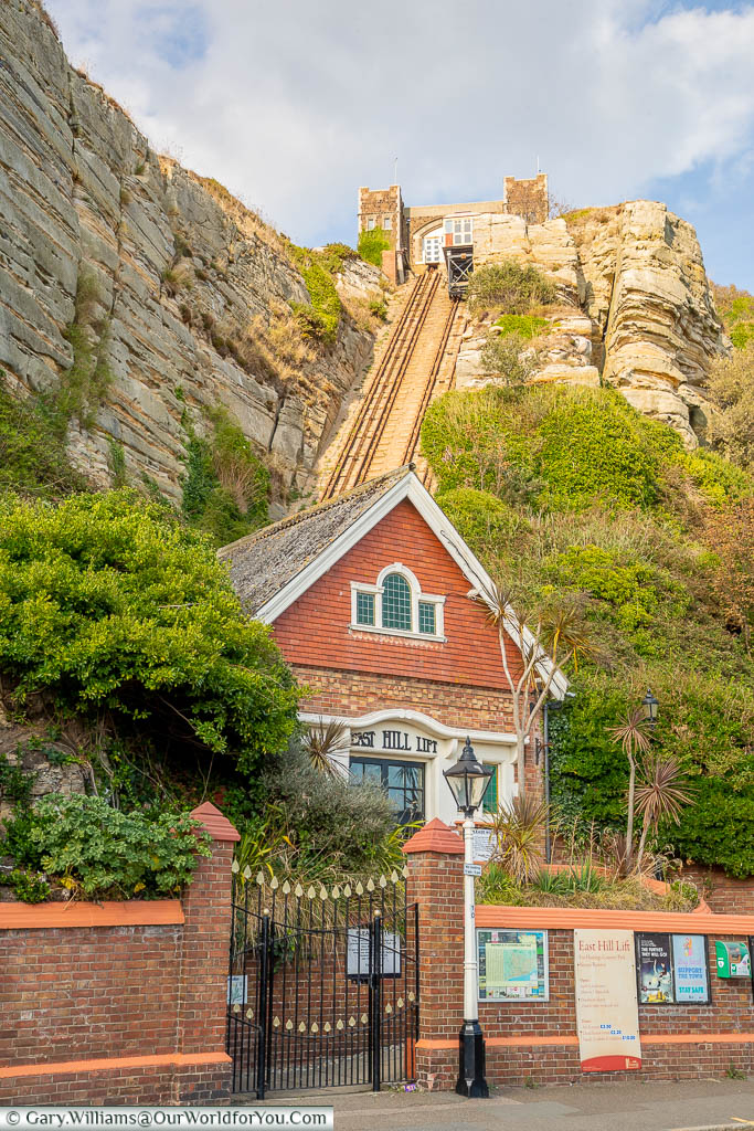The stone waiting room at the bottom of the East Hill funicular railway, with the tracks leading up to the station on top of Hasting's cliffs