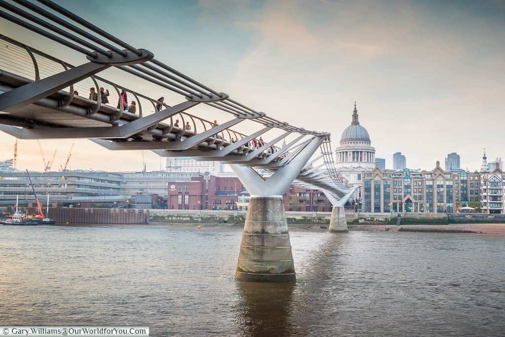 The Millennium Bridge, also known as the Wobbly Bridge, across the River Thames with St Paul's cathedral in the background.