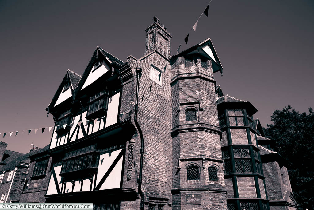 A sepia-toned image of Eastgate House in Rochester, which has a very Dickensian feel to it, akin to an image you'll expect in a Christmas Carol
