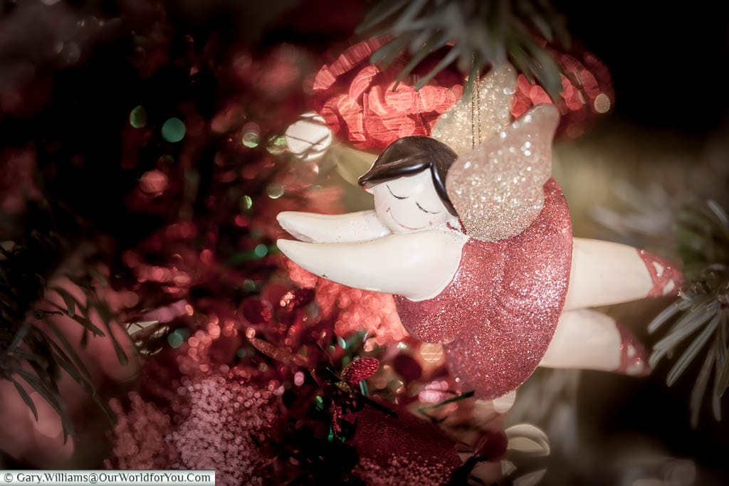 A close-up of a flying red fairy Christmas decoration on our tree